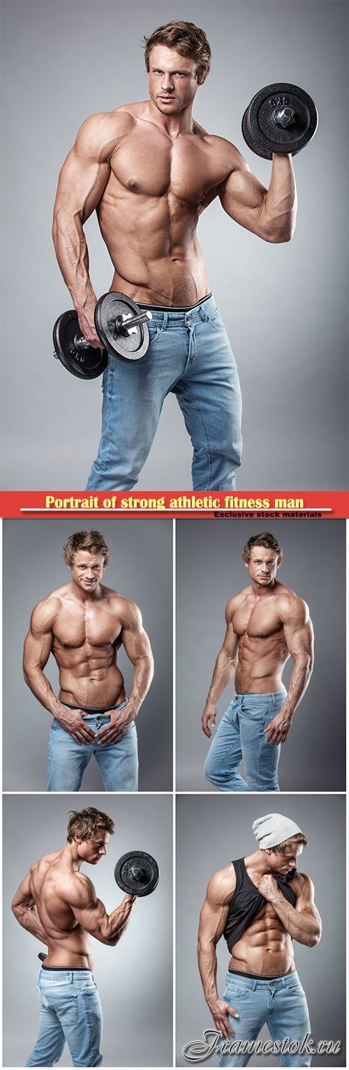 Portrait of strong athletic fitness man  over grey background