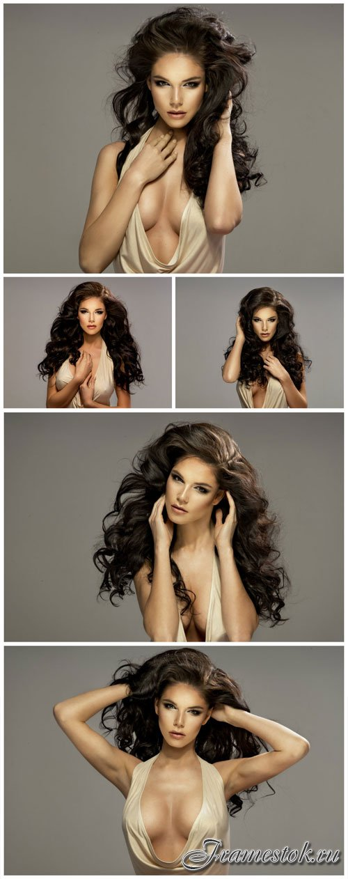 Luxurious brunette with curly hair stock photo